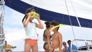 kids preparing to snorkel out on the water