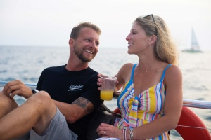 image of a couple enjoying their time on a boat
