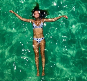 image of a woman floating in the water during an Island Time Sailing Trip