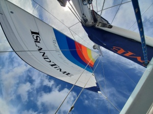 image of a low angle view of the sail on an Island Time Sailing boat