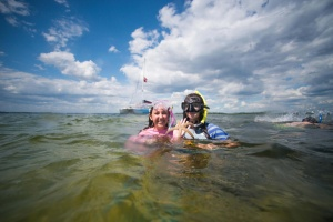 image of two people swimming in the water during a snorkeling trip