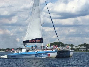 image of an island time sailing boat on the water