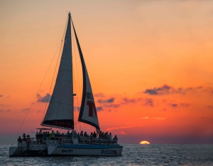 image of an Island Time Sailing boat on the water during a sunset cruise